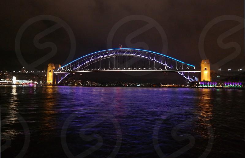 Sydney Harbour Bridge all lit up from the water Sydney Australia.  #lights #night #water #bridge  photo