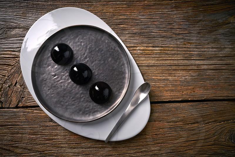 Molecular cuisine concept spheritions black jelly texture photo