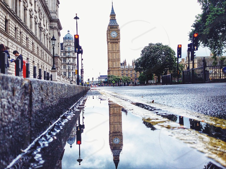 big ben tower with reflection on water photo