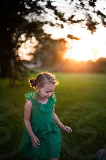 Sunset childhood joy smile happy laugh carefree green outdoors nature child kid lifestyle photo