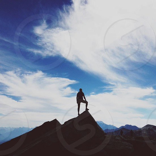 person standing on cliff photo