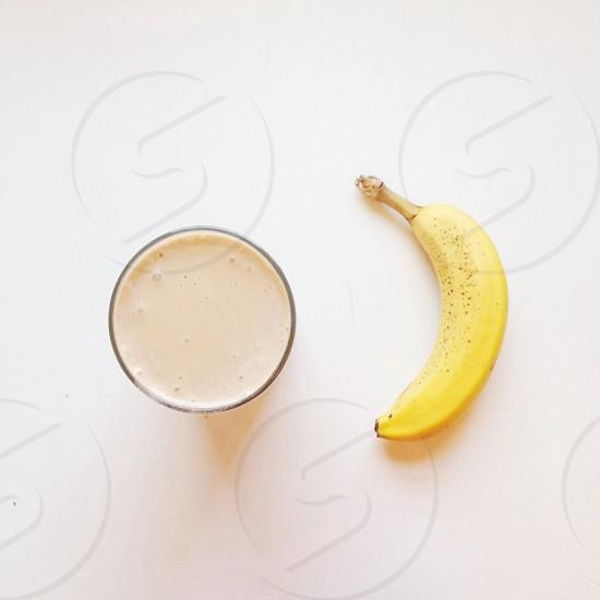 yellow banana near clear drinking glass photo