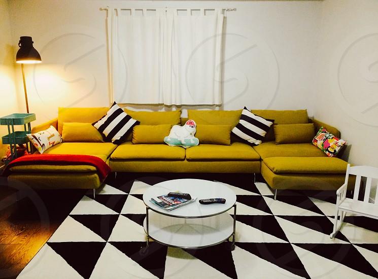 Urban living family room interior design sofa coffee table rug lamp hardwood floor photo