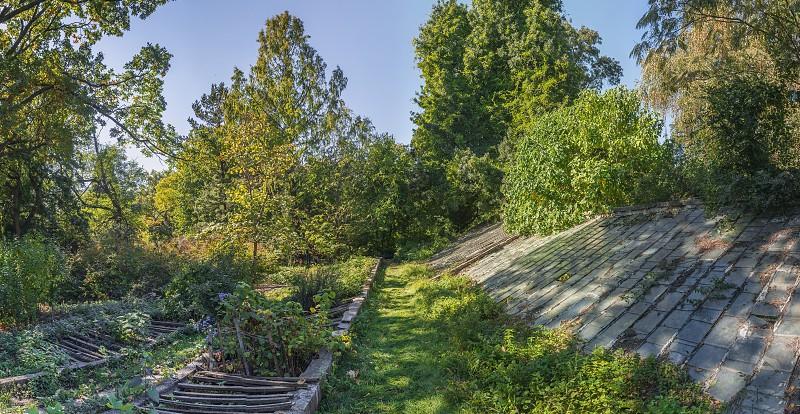 Cozy deserted corner of the old botanical garden in Odessa Ukraine on a sunny autumn day photo