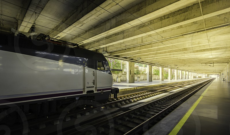 High speed electric train in the station and platform nobody Spain photo