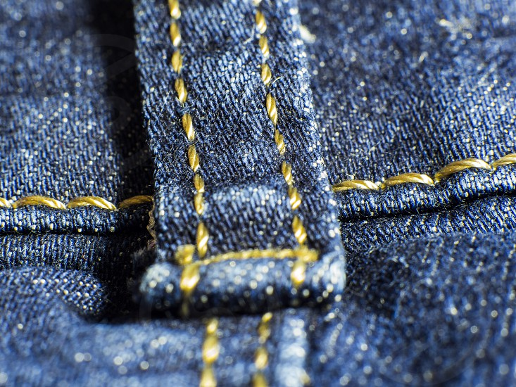yellow seam on jeans trousers photo