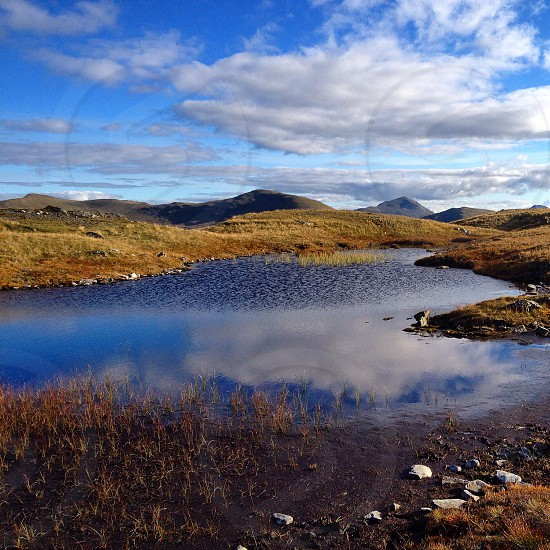 Meall Glas and Ben More   Mountains mountaineering climbing outdoors Munro landscape scenery lochan nature Scotland highlands  photo