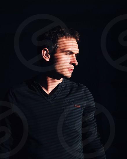 man in black v neck long sleeved shirt photo