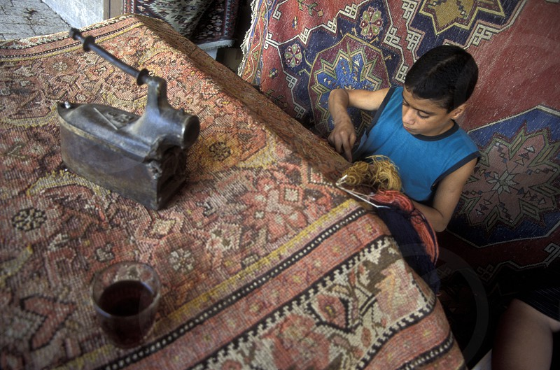 a carpett factory in the market or souq in the old town in the city of Aleppo in Syria in the middle east photo