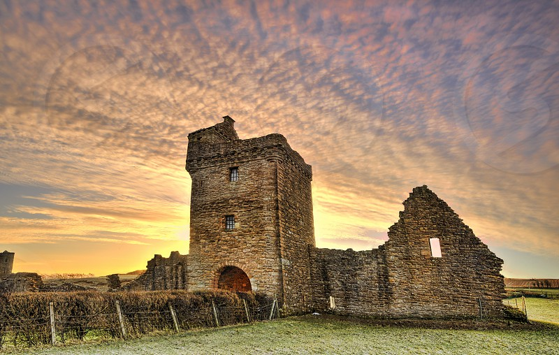 Sunrise over the ruins of the Abbey of Saint Mary of Crossraguel.  A derelict  former abbey near the town of Maybole South Ayrshire Scotland. photo