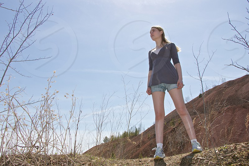 woman with blond hair wearing blue dress and gray shorts photo