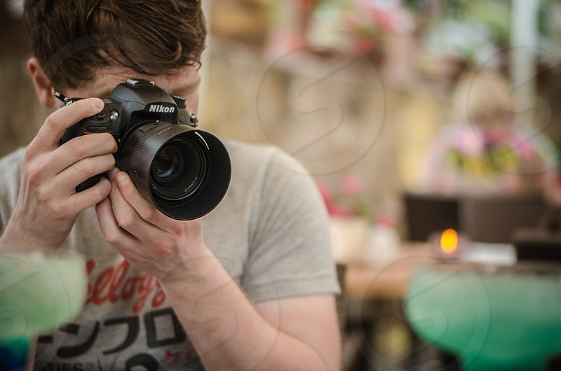 A photographer taking a photo. photo