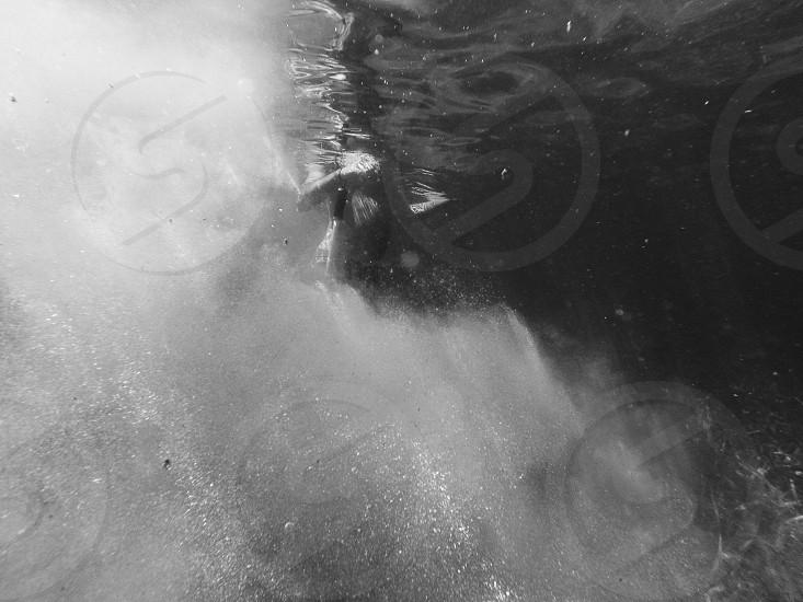 person swimming on the sea photo