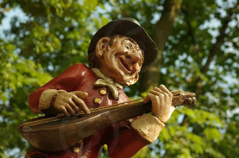 Guitar puppet fairy tale themepark colour midget statue photo
