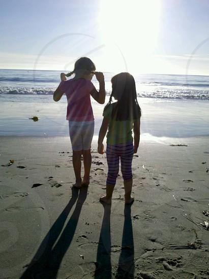 Two girls playing at Laguna Beach CA photo