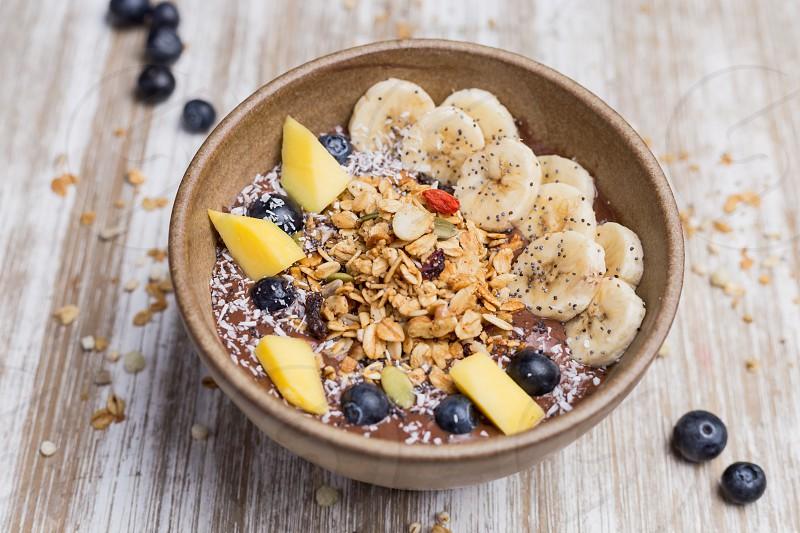 Healthy banana dessert with oat and yogurt photo