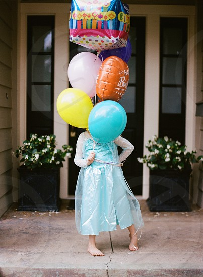Celebration girlbirthday 5 years old lifestyle Elsa balloons little girlfun bluetulle.  photo