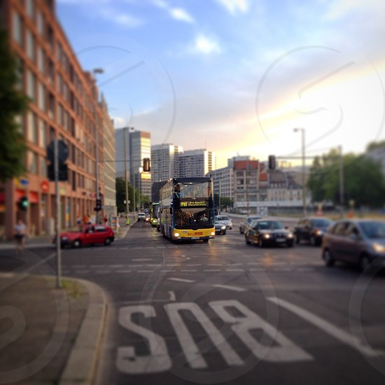 double decker bus in road with cars photo