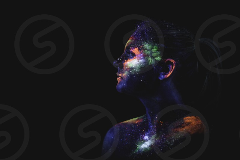 Conceptual shot of light and shine fluorescent colors young girl's face photo