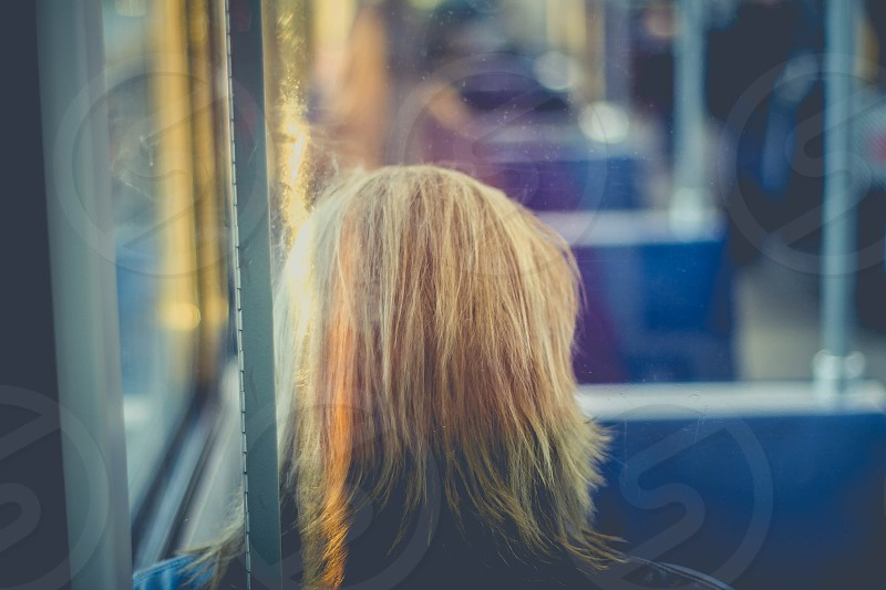person sitting on blue bus seat photo
