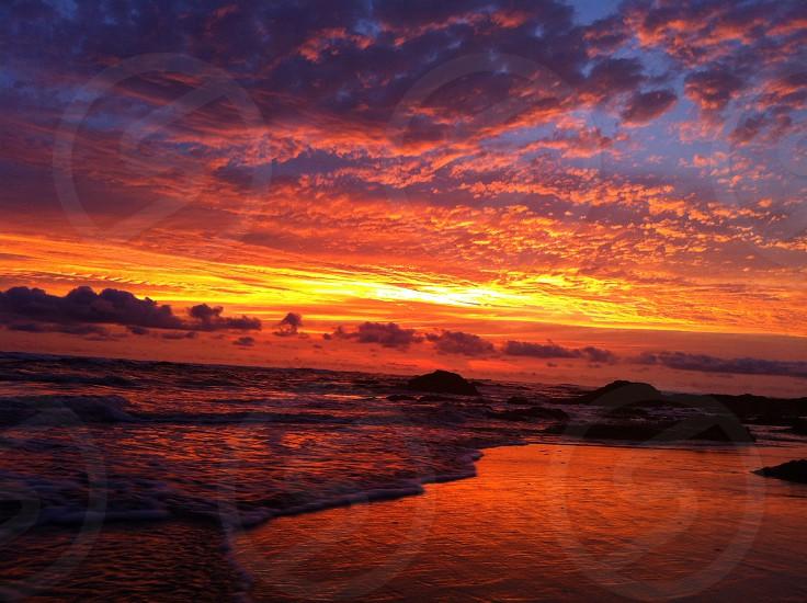 sunset on shore photo photo