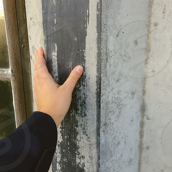 hand inspecting building surface photo
