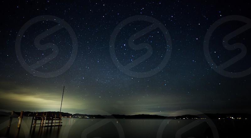 Lake Tahoe starry night sky pier photo