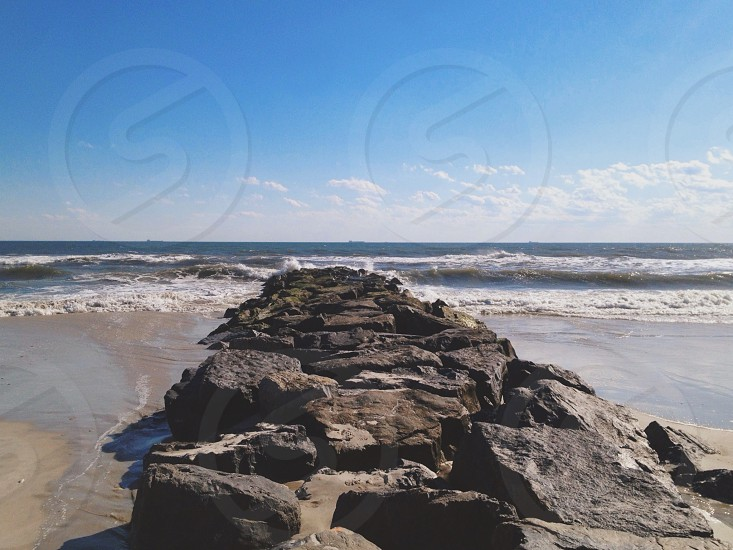 landscape photography of boulders on seashore photo