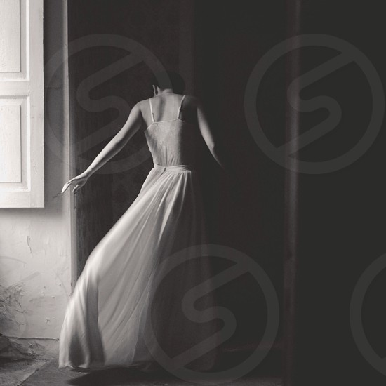 woman wearing white chiffon maxi skirt and white cami photo