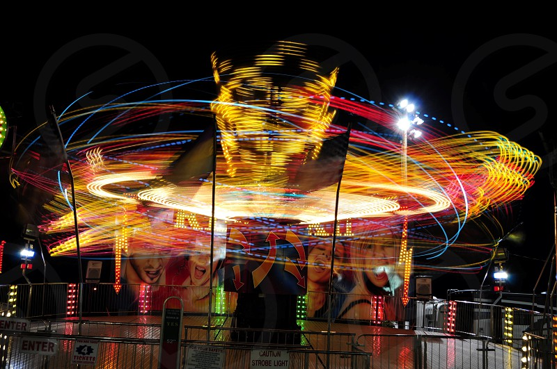 CARNIVAL COLOR TRAILS LIGHT TRAILS LONG EXPOSURE MOTION BLUR MOTION NIGHT RIDES SPINNING photo