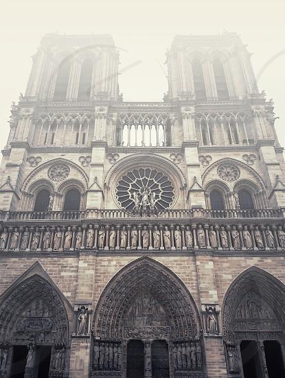 Facade of Notre Dame de Paris cathedral in a foggy morning. photo