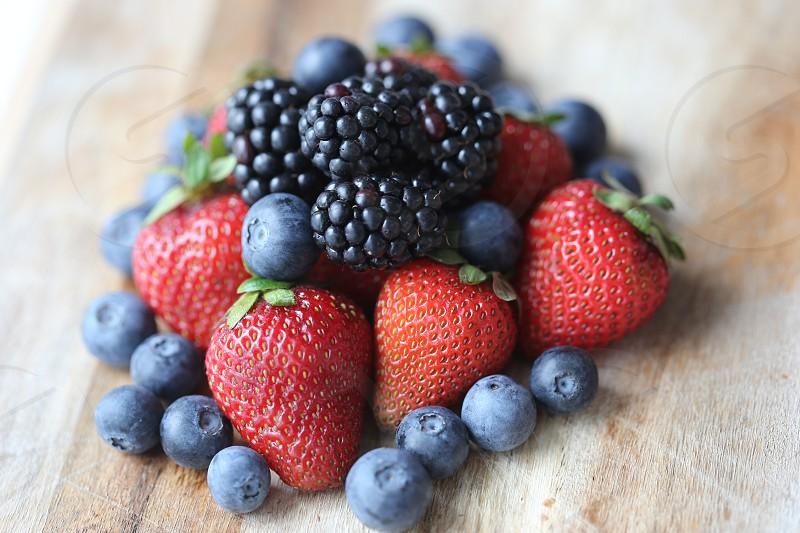 strawberries and black raspberry photo