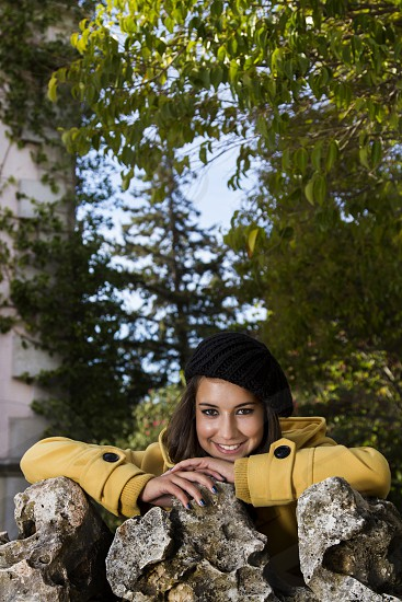 beautiful; girl; happy; happiness; cute; woman; autumn; seasonal; clothing; fashion; pose; casual; urban; yellow; jacket; tree; outdoor; plant; foliage; vegetation;  photo