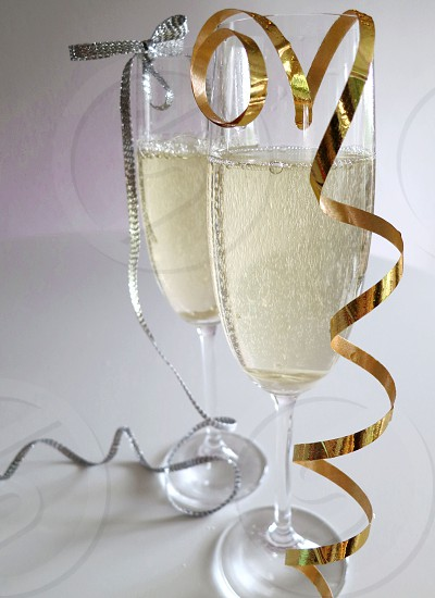 Champagne flutes gold and silver ribbon photo