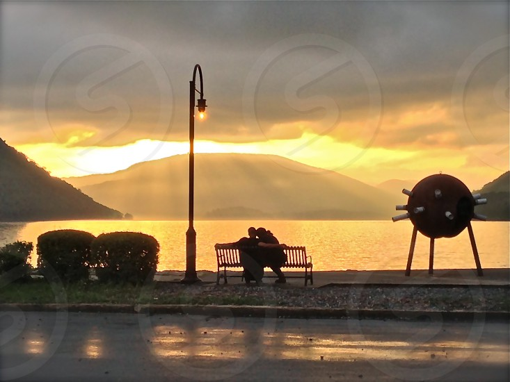 Bench sunset mountain couple photo