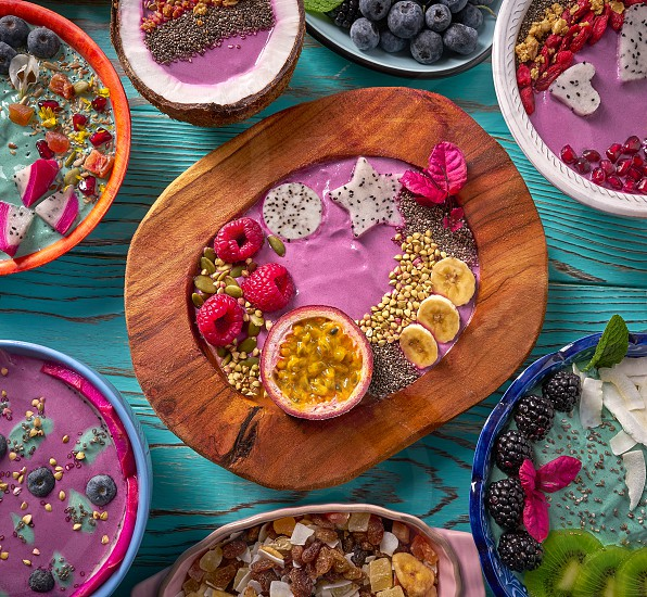 Acai bowl smoothie and Spirulina algae with chia berries and fruits healthy food photo