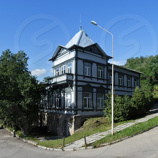 PETROPAVLOVSK CITY KAMCHATKA PENINSULA RUSSIAN FAR EAST - SEP 7 2015: Summer view of old wooden building of museum of local lore - Kamchatka Regional Unified Museum in Petropavlovsk-Kamchatsky City photo