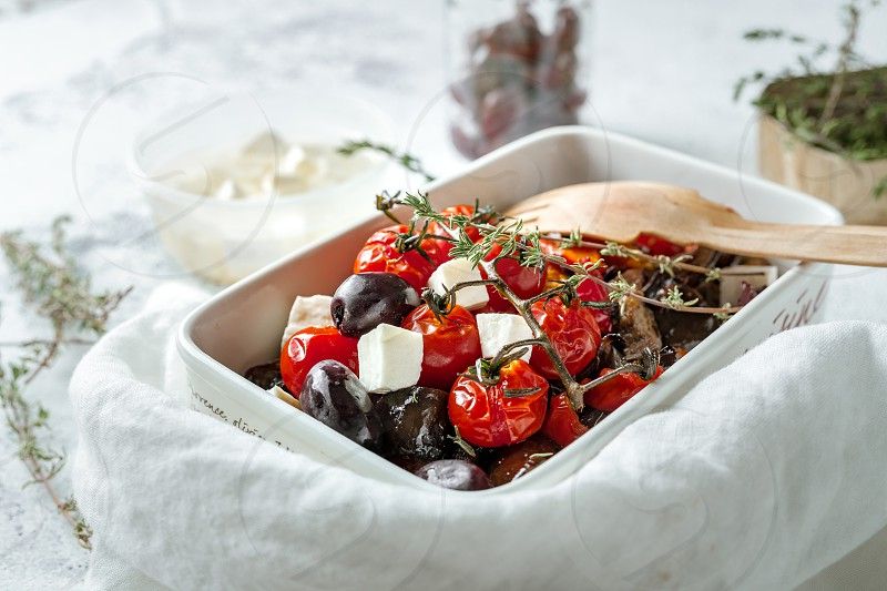 Balkan style warm salad of roasted vegetables and feta cheese photo