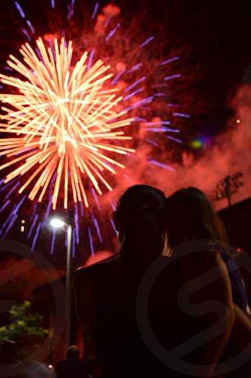 two person watching fireworks during night photo
