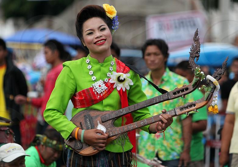 ASIA SOUTHEASTASIA THAILAND YASOTHON FESTIVAL MUSIC WOMEN TRADITION CULTURE ISAN photo