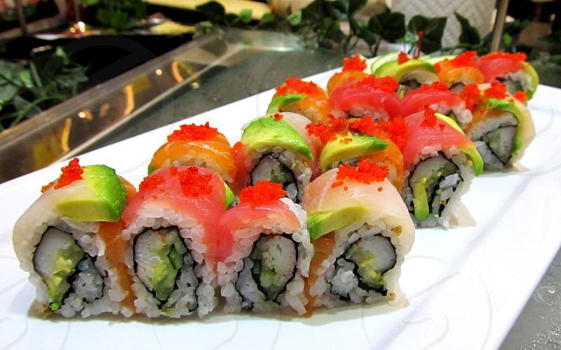 Sushi -- rainbow roll slices on platter photo