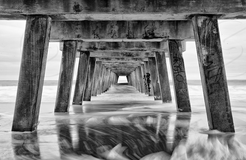 Repeating pattern under pier at the beach. photo