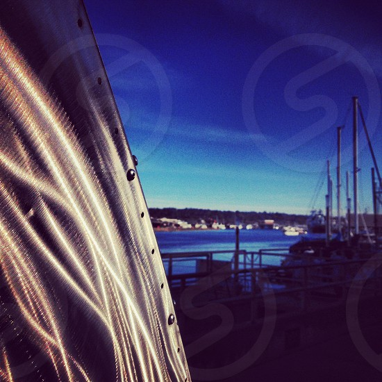 Sculpture next to water and boats located in Ballard Locks in Seattle WA. photo