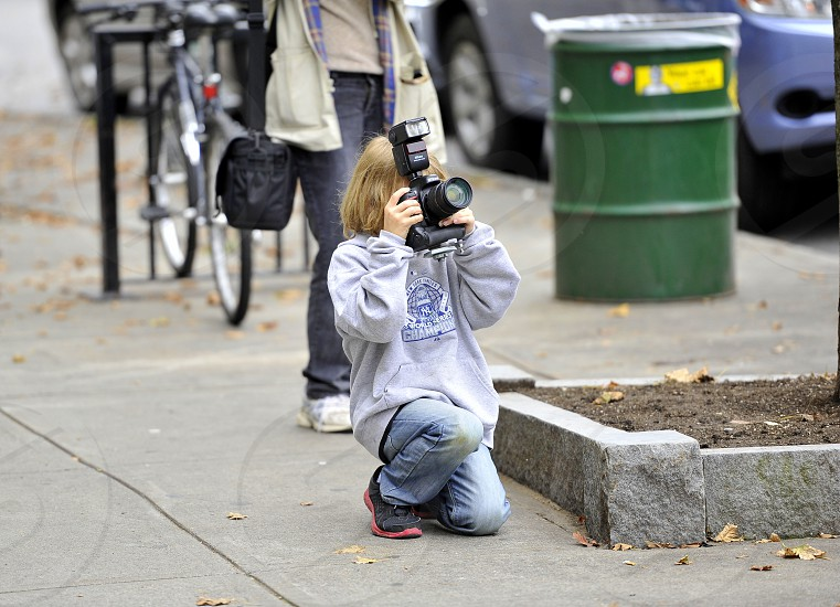 Young man taking photo with DSLR. photo