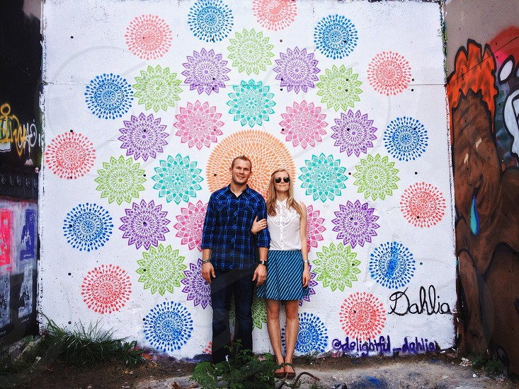 woman standing next to man photo