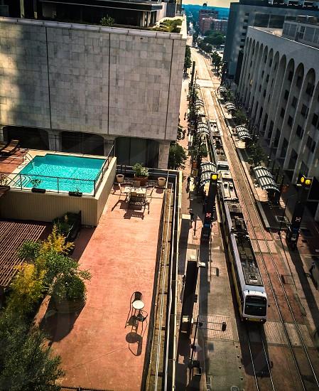 Dallas Texas lifestyle rooftop living metro rail train city urban pool view downtown cityscape photo