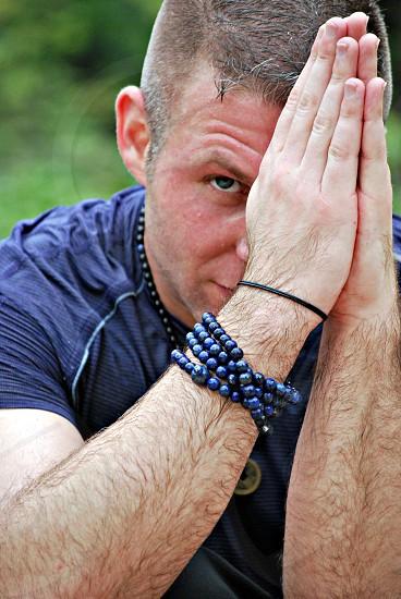Man praying in yoga shoot photo