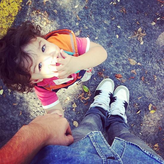 little girl holding man's hand photo