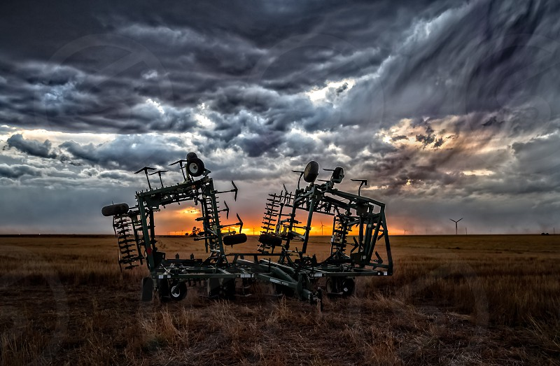 Harrows at sunset on a Kansas wheat field. photo