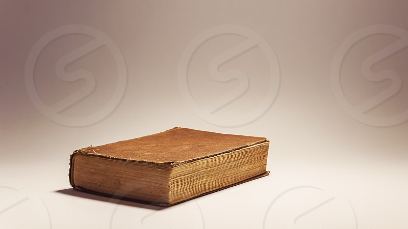 Conceptual composition about reading books old retro look book on white background.  photo